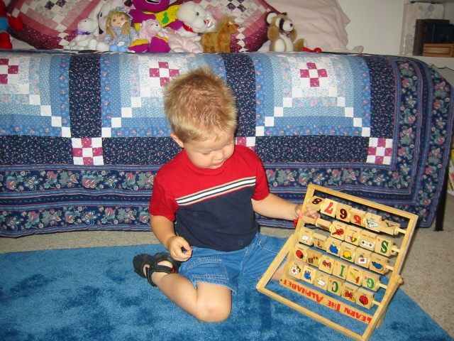 Playing with an alphabet toy