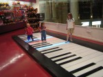 Kids on a big floor piano