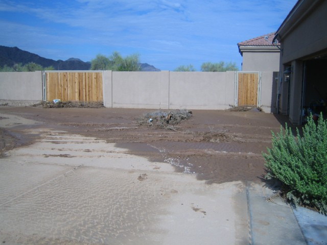 The driveway leading into the garage. Notice the water level mark on the wall.