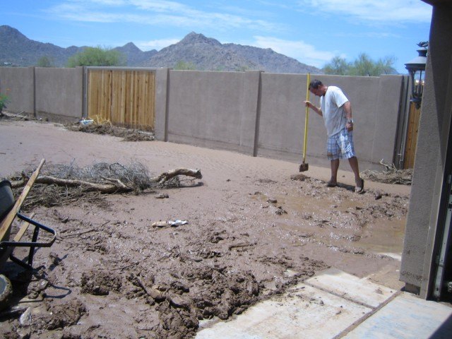A neighbor helping muck out the garage.