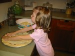 Megan helping make pizza