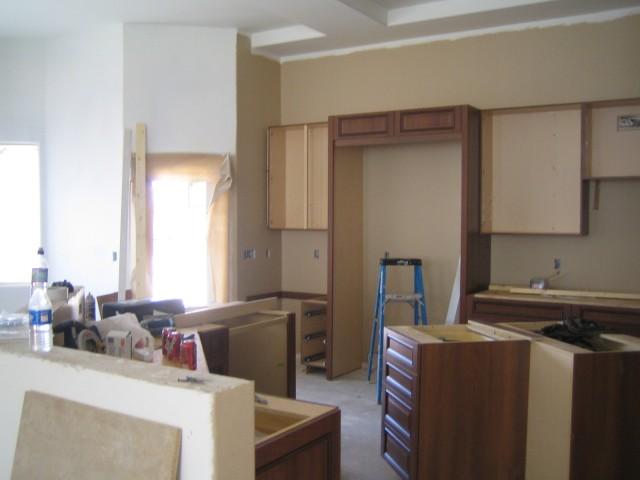 Kitchen (during cabinet installation, before granite)