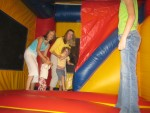 Carrie's cousin, Ashley & Caelyn getting in the blow up tent with Carrie & Lauren
