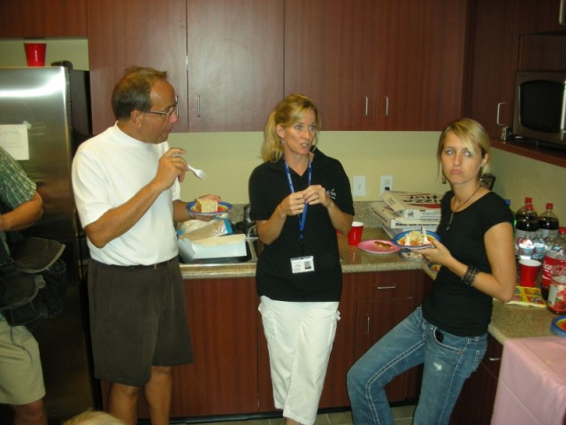 The Make A Wish volunteers enjoying cake