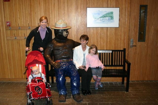 Family with Smokey Bear