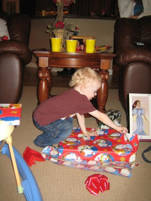 Steven opening a present