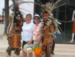 Becky & Wendy with costumed warriors in Playa de Carmen.