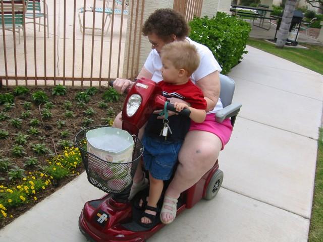 Nathan and Great Grandma looking at flowers