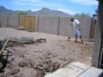 A neighbor helping muck out the garage. (That's the driveway under the mud.)