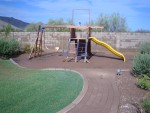 Playground. The ground cushion is completely covered with mud.