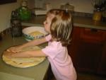 Megan helping make pizza