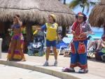 Costumed staff members leading water aerobics