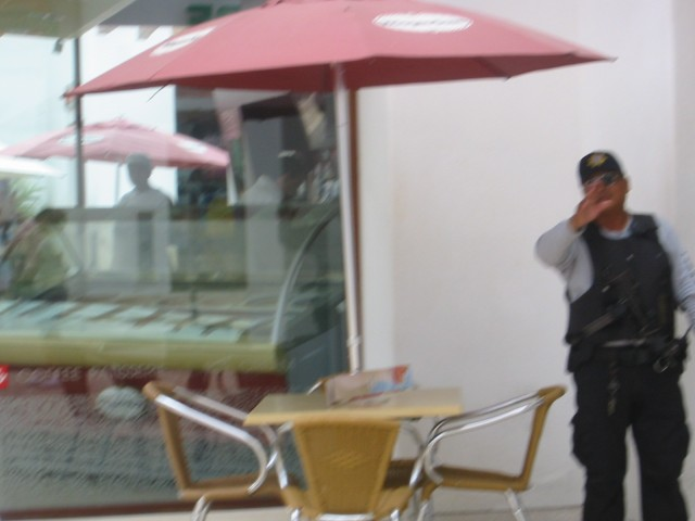 This heavily armed policeman didn't want his picture taken.