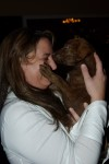 After furious bidding and $1075, this chocolate lab was hers!
